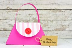 Mothers Day purse gift bag with tag over white wood Royalty Free Stock Photography