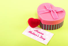 Mothers Day. Red Heart heart shaped gift box with a mothers day card royalty free stock image