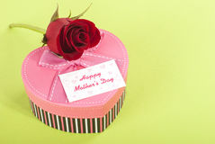 Mothers Day. Red rose Heart shaped gift box with a mothers day card royalty free stock photography