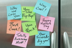 Mothers Day Sticky Notes on a Refrigerator. Mothers Day Sticky Notes on a stainless steel Refrigerator stock photos