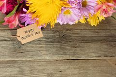 Mothers Day tag with flower border on wood Stock Image