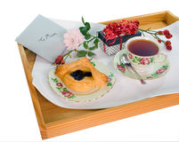 Mothers Day Treat. On a tray for Mum, isolated on white background with clipping path Royalty Free Stock Photo