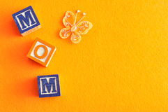 Mothers day. The word mommy spelled with alphabet blocks against an orange background Stock Photos