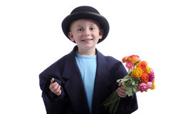 Mothers day: young boy with flowers Royalty Free Stock Photography
