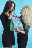 Mothers day -  young woman give a present at her mom Royalty Free Stock Photography