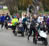 Mothers, father, and babies at the Drumstick Dash, Roanoke, Virginia, USA
