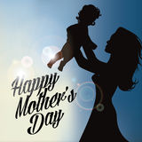 Mothers holding up baby silhouette Royalty Free Stock Photos