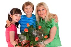 Mothers and kids with bouquet Stock Photos