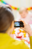Mothers making photos of babies first birthday Royalty Free Stock Photos