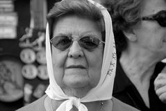 The Mothers of the Plaza de Mayo. BUENOS AIRES, ARGENTINA - NOV 17: An unidentified woman marches in Buenos Aires, Argentina with The Mothers of the Plaza de stock images
