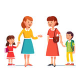 Mothers with school and kindergarten boy and girl. Two mothers with school first grader and kindergarten kid boy and girl meet and talking to each other Royalty Free Stock Images