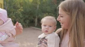 Mothers with small children walking on the playground stock video footage