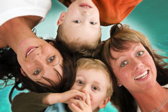Mothers and sons collection. Two sisters with sons lying on the bottom with green background Royalty Free Stock Photos