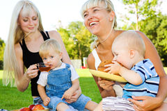 Mothers and their babies eating stock image