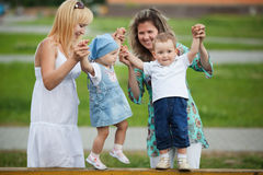 Mothers with their children on playground Stock Images