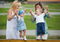 Mothers with their children on playground Stock Photography