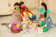 Mothers with their kids Stock Photography