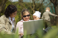 Mothers are using a laptop Stock Photo