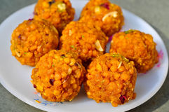 Motichoor ka Ladoo. Is a sweet food of India made from grilled gram flour flakes which are sweetened, mixed with almonds, pressed into balls and fried in ghee Stock Images