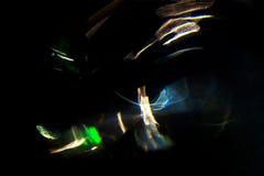 Motie van de hoge resolutie vertroebelde de Abstracte gloeiende cirkel achtergrond in donkere levendige rood, groen, geel, blauw Stock Afbeelding