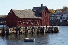 Motif #1. Rockport inner harbour showing a boat with lobster traps and Motif #1. 'Motif Number 1', a small fishing shack, has for years been one of the most Stock Images