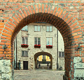 Motif with ancient arch and medieval street in old European town Royalty Free Stock Photo