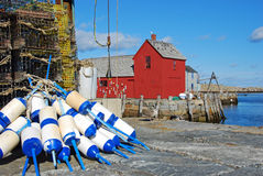 Motif No. 1 and Blue Buoy. Historic Motif No 1 in Rockport MA Royalty Free Stock Photography