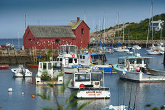 Motif #1, Rockport, Massachusetts, USA. Old fishermen's shed stands in the middle of Rockport harbor. It is painted by many local artists due to it's history Royalty Free Stock Photos