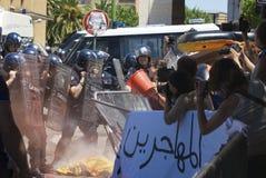 Motim. Estudante e polícia fotos de stock royalty free