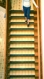 Motion. Woman walking down stairs royalty free stock photography