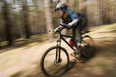 Motion 2. Woman-biker blurred in motion. Cross-country Royalty Free Stock Image