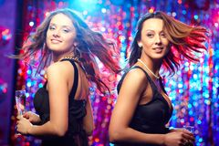 In motion. Image of adorable girls in motion enjoying themselves in the club Royalty Free Stock Image