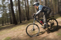 Motion 4. Woman-biker blurred in motion. Cross-country Royalty Free Stock Image
