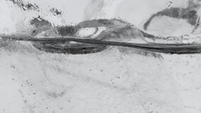 The motion of air bubbles of mineral carbonated water with ice in clear glass.