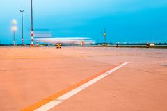 Motion aircraft in airport blue hour Royalty Free Stock Photos