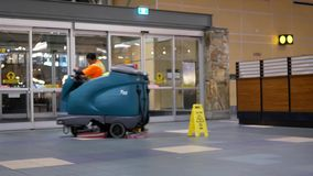 Motion of airport workers cleaning floor during night inside YVR airport
