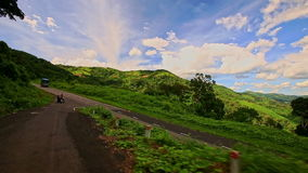 Motion along Curvy Country Road among Green Hilly Landscape stock video