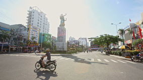 Motion along Monument on Streets Crossroad with Small Traffic. NHA TRANG, KHANH HOA/VIETNAM - JANUARY 26 2017: Motion along big monument on wide streets stock video footage