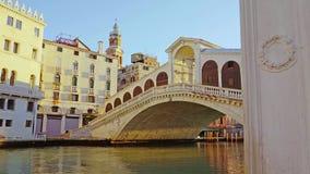 Motion along channel to historical Rialto bridge in Venice