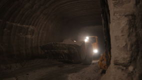 Motion aside to underground tunnel and driving dumper stock video