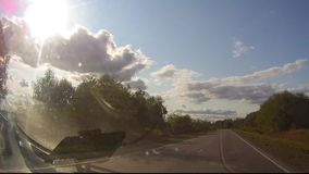 Motion asphalt road at sunset with blur car truck . Car on asphalt road in beautiful spring day at countryside. Motion asphalt road at sunset with blur car truck stock video footage