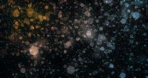 Motion background falling defocused orange blue bokeh lights snow loop 4k stock footage