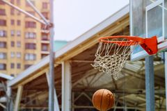 A motion of basketball swishing through the hoop. The basket, close up view royalty free stock photography