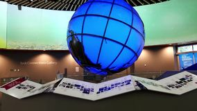 Motion of big screen and globe inside Vancouver aquarium stock video