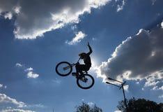 Motion biker jumps Stock Images