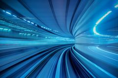 Motion blur of Automatic train moving inside tunnel in Tokyo, Japan Stock Photo