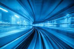 Motion blur of Automatic train moving inside tunnel in Tokyo, Japan Royalty Free Stock Photography
