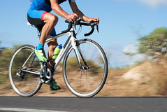Motion blur of a bike race with the bicycle and rider. At high speed Stock Image