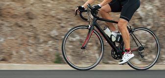 Motion blur of a bike race. With the bicycle and rider at high speed Royalty Free Stock Images