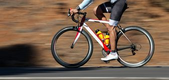 Motion blur of a bike race with the bicycle and rider. At high speed stock photo